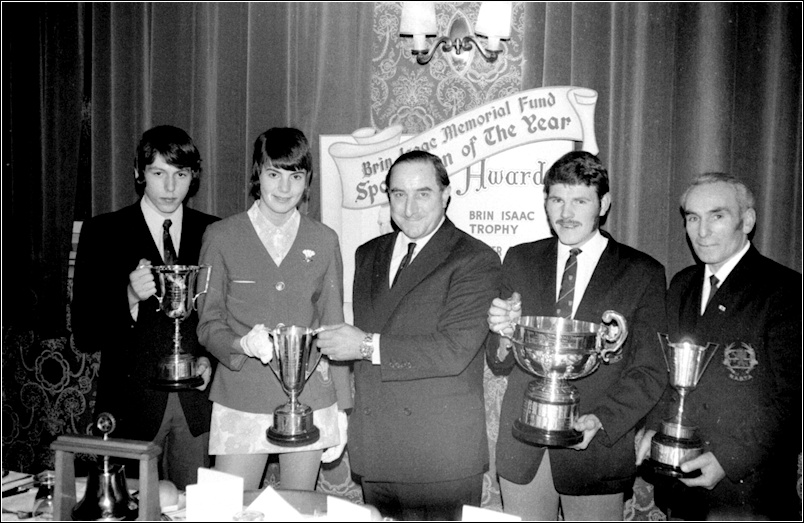 December 1970. Brian Trubshaw presents trophies at the 'Brin Issac Memorial Fund, Sportsman of the Year' 1970, at the Stepney Hotel, Llanelli. L-R 'Walter Hughes Cup' winner, Stephen Kohut. 'Star Cup' winner, Cheryl Thomas. Brian Trubshaw. 'Sportsman of the Year (soccer)' Gil Lloyd. 'Guardian Cup' winner, Henry Thomas. Photograph courtesy of Nevill Tonge.