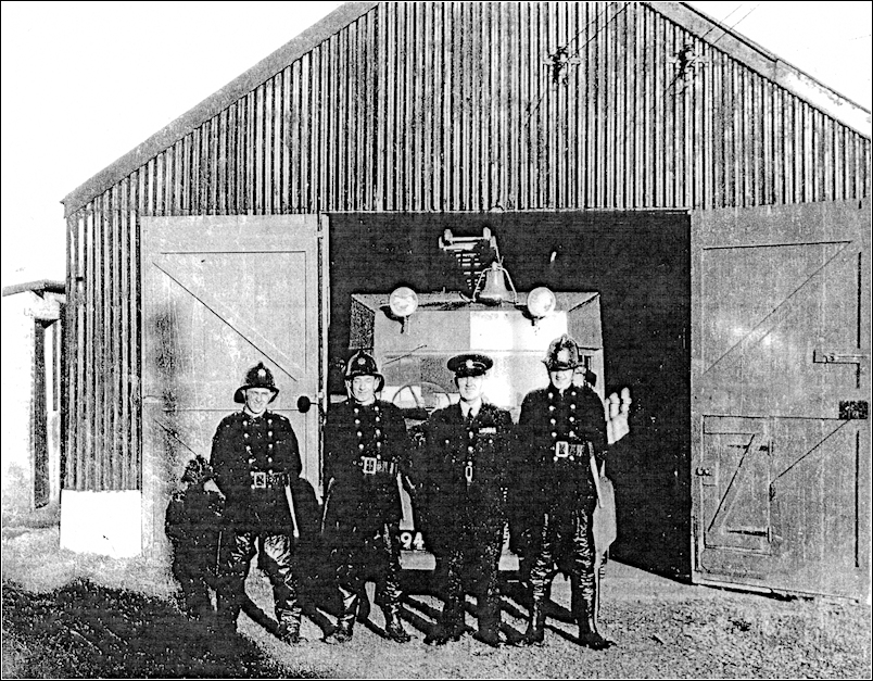Pontyates Fire engine and Crew L-R Gareth Gravell, John Campbell Jones, Cyril Rogers (the Station officer) and Ron Lewis
